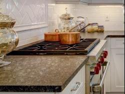 Granite countertops with flamed finish. Ceramic brick backsplash tile.