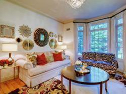 Living room with new furnishings, lighting, window treatments and accesories