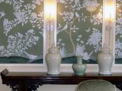 Detail of hand-painted panels set into new mouldings and new wall sconces