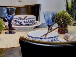 Detail of blue and white tableware with recycled cobalt glassware.