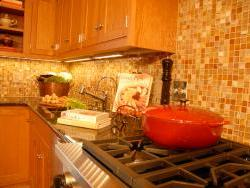 East Windsor cooktop, cabinetry and faucet detail